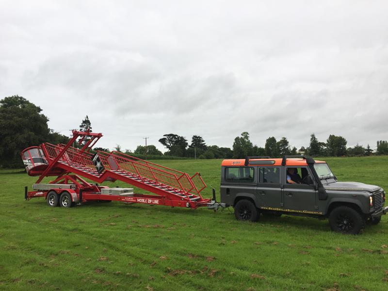 Orangeworks Landrover Defender transporting our Mobile Zip Line