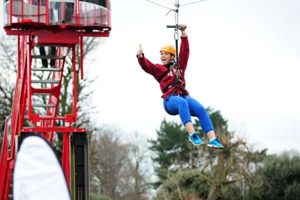 Delegate giving thumbs up whilst going down our Mobile Zip Line