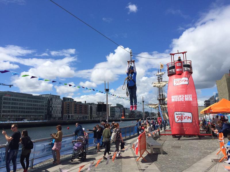 A delegate swinging across Orangeworks mobile Zip Line at a 98fm event in Dublin.