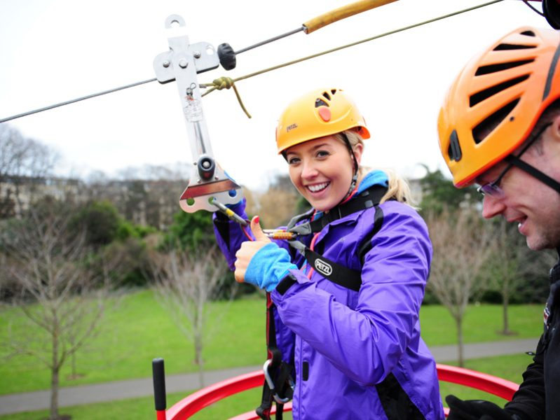 Delegate giving thumbs up before she completes Orangeworks zip lining course.