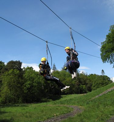 Delegates swinging down on Orangeworks Mobile Zip Line at Carton House
