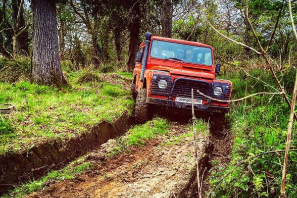 Orangeworks Landrover Defender driving through our muddy tracks at Carton House