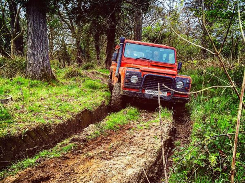 Orangeworks Landrover Defender driving through our muddy tracks at Carton House