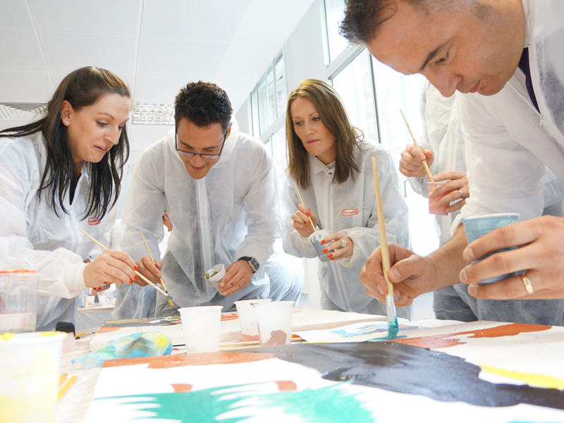 Delegates of the Big Picture painting their canvases during the creative team building challenge by Orangeworks.