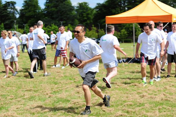 Delegates playing American football during Corporate Sports Day