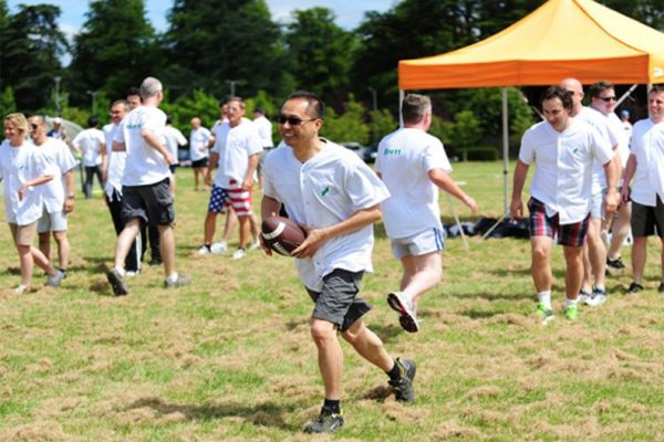 Delegates playing American football during Corporate Sports Day with Orangeworks.