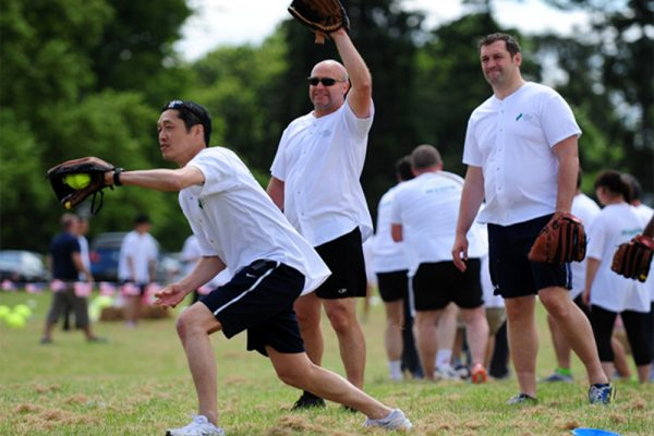 Delegates take part in baseball during their Corporate Sports Day.