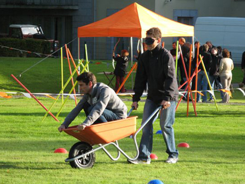 Delegates taking part in blindfold wheel barrow racing during their Corporate Sports Day.