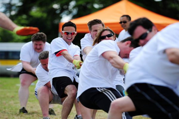 Delegates compete in a game of tug of war.