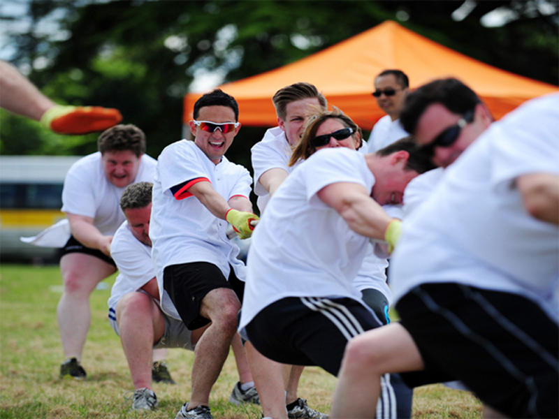 Delegates compete in a game of tug of war.during their outdoor corporate sports day hosted by Orangeworks.