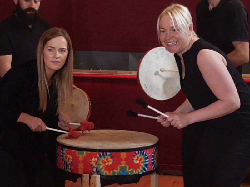 Delegates watching for the signal to drum during Global Grooves, a fun samba style team building event by Orangeworks.