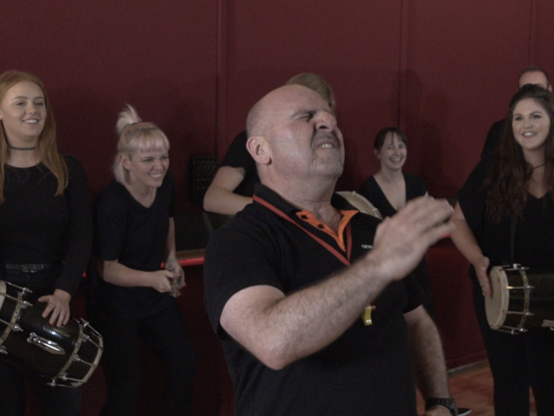 Ed Freitas and delegates getting into the groove while playing their instruments during Global Grooves by Orangeworks.