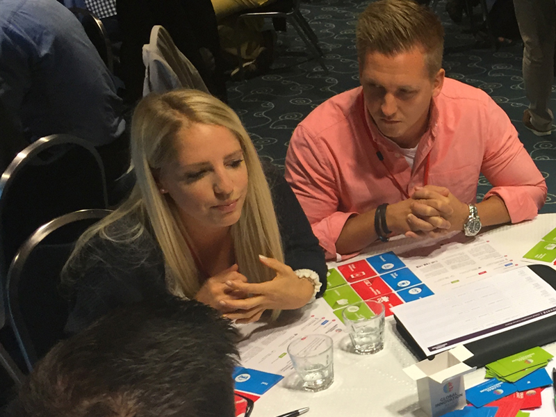 Delegates discuss their innovative ideas during Global Innovation Game, an innovative team building experience by Orangeworks