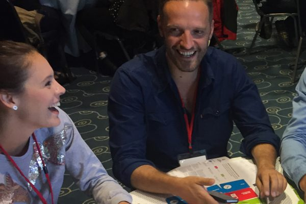 Delegates smiling during the Global Innovation Game