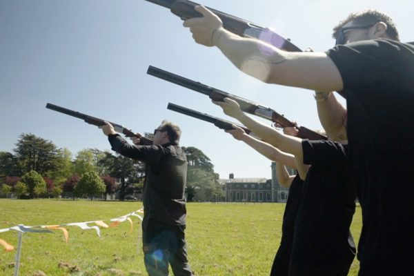 Delegates taking part in Laser Clay Pigeon Shooting event