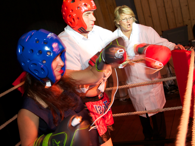 Delegates wearing boxing gloves and helmet as they begin Push It, a fun, high energy, active corporate team activity.