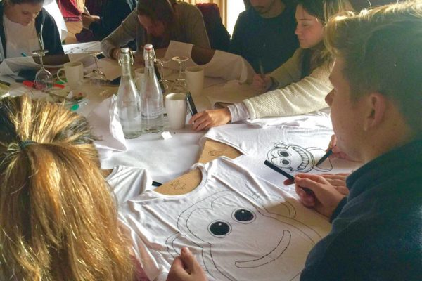 Delegates designing their t-shirts during T-shirt Masterpiece the team building event by Orangeworks.