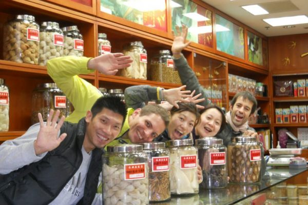 Delegates smiling in a local shop during Travel Show team building event