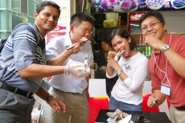 Delegates trying some food during Travel Show, the creative team bonding exercise by Orangeworks.
