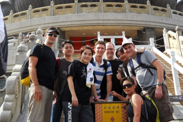 Team smiling for a photo during Travel Show team building event