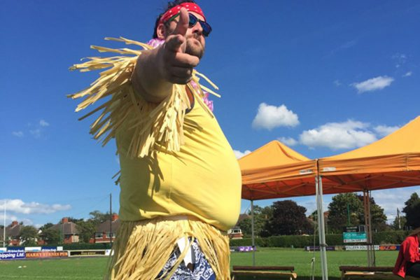Oddie, Orangeworks MC, dressed up in Hawaiian clothing for Two Tribes outdoor team building activity.