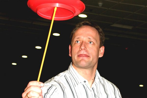 Delegate focusing on balancing a plate during Urban Circus, a corporate evening interaction hosted by Orangeworks.
