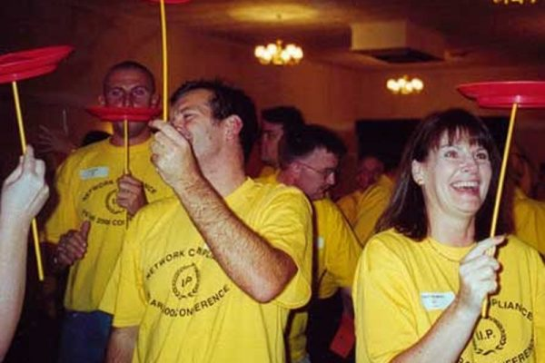 Delegates practising plate spinning for Urban Circus, a team-building event hosted by Orangeworks.