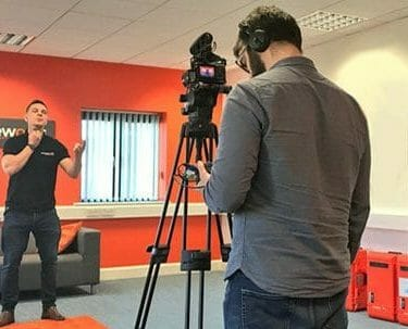 Dean, Orangeworks lead beatboxer filming one of their Bespoke pre-conference icebreakers in the orangeworks offices.
