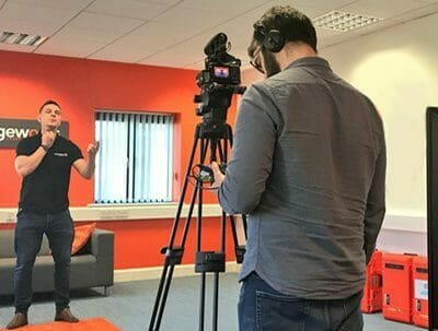 Dean, Orangeworks lead beatboxer filming one of their Bespoke pre-conference icebreakers in the orangeworks offices.