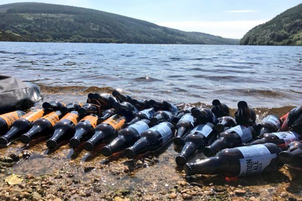 Building a Bespoke Adventure with some Wicklow Wolf Beer chilling in the lake