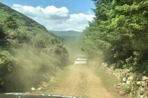 Two orangeworks land rovers driving through an off road track during one of their bespoke adventure activities.