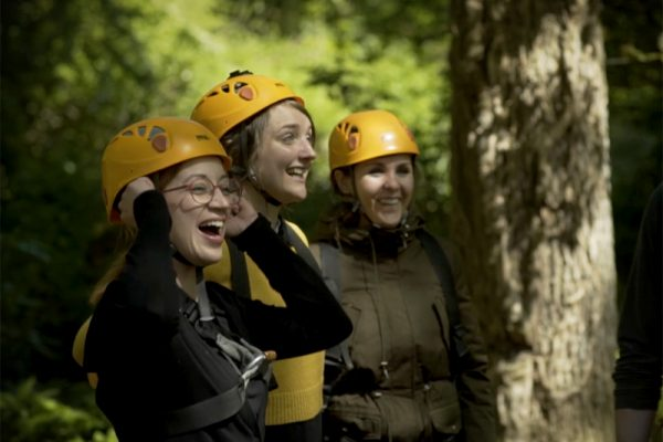 Delegates cheering wearing helmets ready for Altitude High Ropes at Carton House