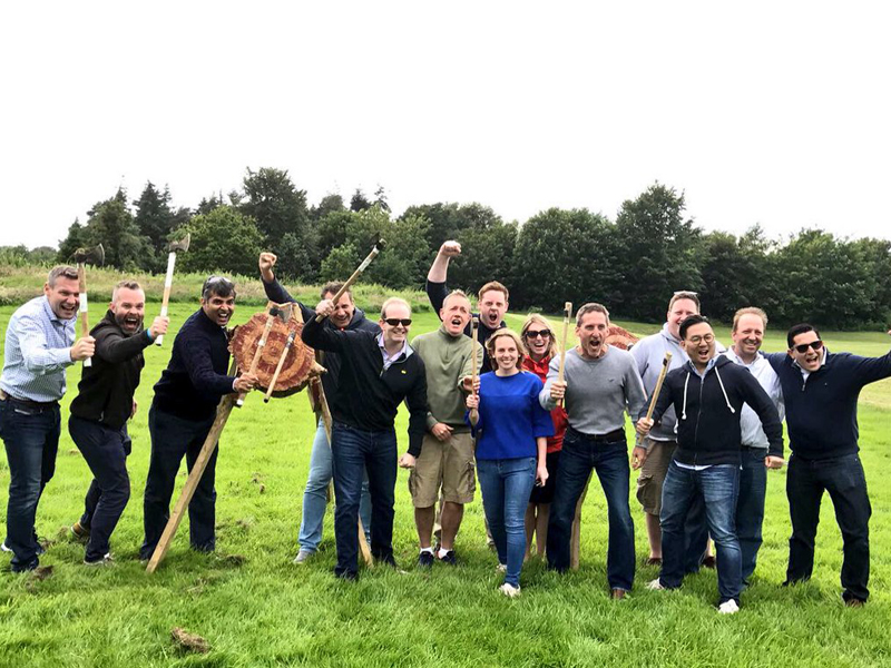 A group of delegates posing with axes in hand during the Orangeworks team building Multi-Activity Day at Carton House.