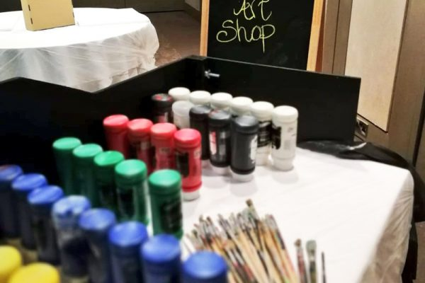 The Big Picture Art Shop filled with different colour paints and paintbrushes.