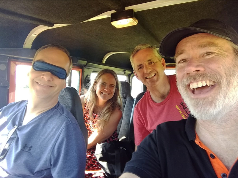 Group selfie whilst taking part in Blindfold Driving, a fun corporate team bonding activity hosted by Orangeworks.