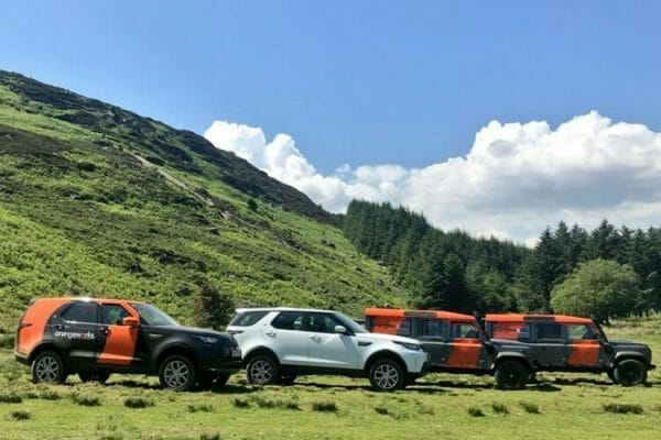 Land Rovers parked and ready for one of Orangeworks outdoor bespoke adventure