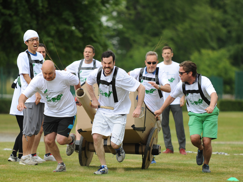 Delegates pulling their chariot during the finale race of the team building activity called Flat Out Chariots.