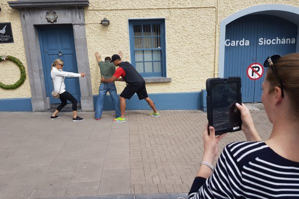 Team completing a photo challenge outside a Garda station
