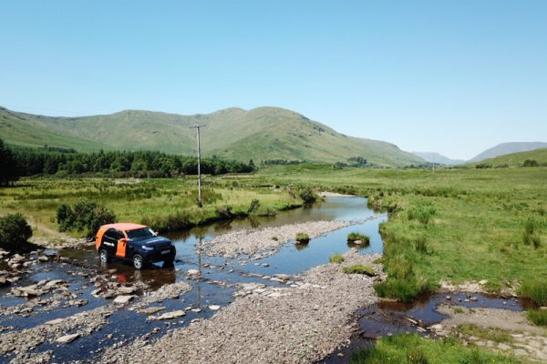 Orangeworks Land Rover Discovery crossing a river