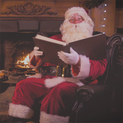 Santa Claus sitting by the fire