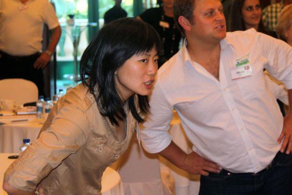 Delegates taking part in Tai Chi exercises
