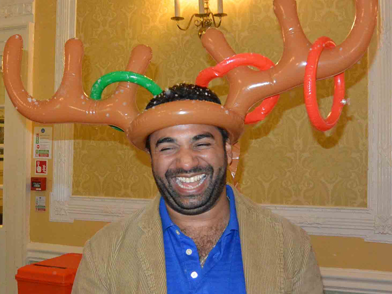Laughing delegate wearing reindeer antlers as part of a Quickfire Christmas challenge