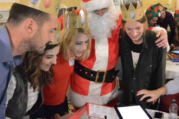 Delegates of the staff Christmas party game Quickfire, working together with Santa to complete the iPad based challenges.