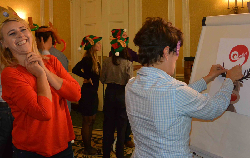 Delegates playing pin the red nose on the reindeer during Quickfire Christmas