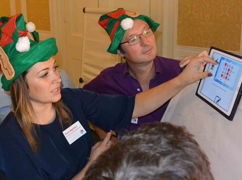 Delegates working on an iPad based challenge during Quickfire Christmas, a corporate Christmas party idea by Orangeworks.
