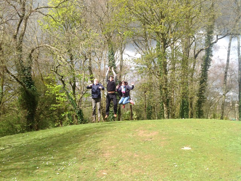 Happy team jumping in the air for a photo challenge during Go Team Fota Park treasure hunt