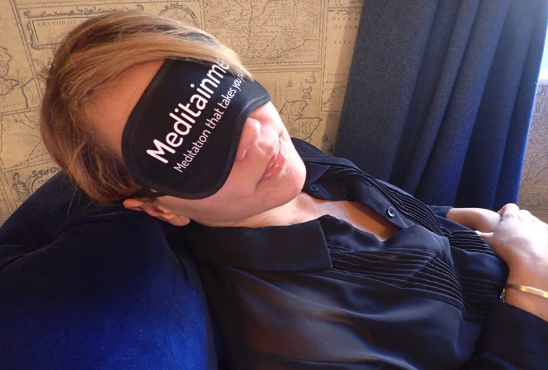Woman wearing eye mask during Meditainment, an employee wellness programme with Orangeworks