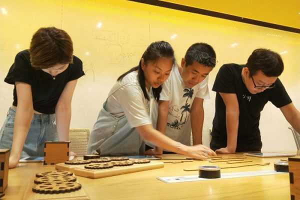 Teams playing Escape the Maze team building game