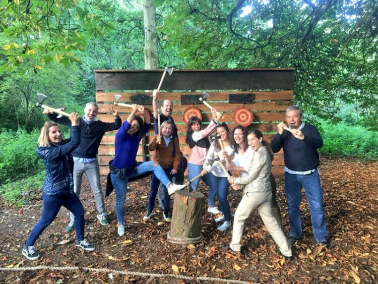 Delegates posing with axes in front of the Axe Throwing station at Carton House.