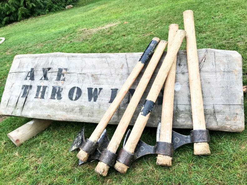 Axes laid out ready for the Axe Throwing team development activity by orangeworks.